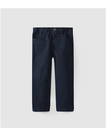 Pantalon en sergé à cinq poches.